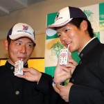 Akihisa Nishida and Tomoya Matano get to work shilling the company product.