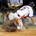 The play at home plate that caused the prolonged uproar in the stands.