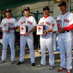Tazawa, Shoda, Matsuzaka and Okajima take donations shortly after March 11th.
