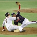 Tanaka did well to hang onto this throw, but Sakamoto was still safe.